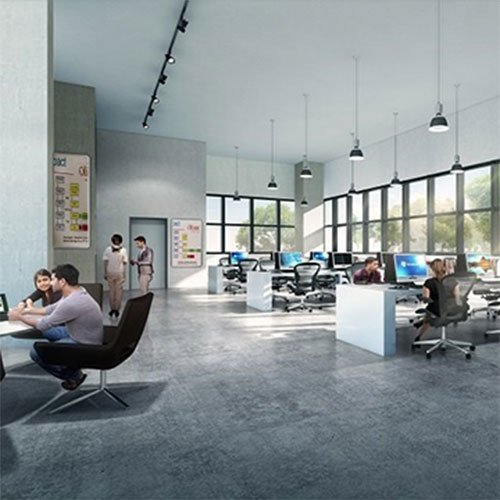 pepople sitting in chairs and desks in an open plan office